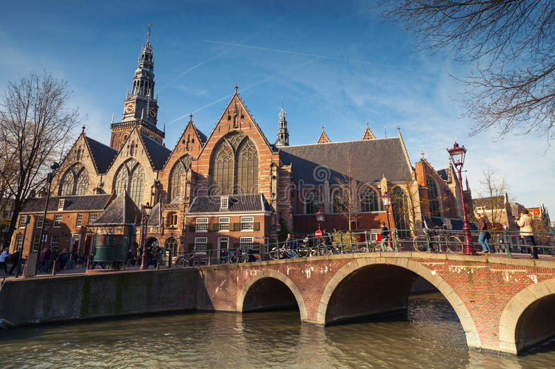 Old church on the canal coast in Amsterdam stock images