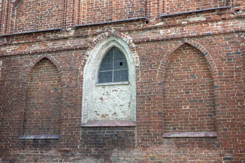 An old church in Central Europe. A religious building of red brick worship. Season of the aun stock photo