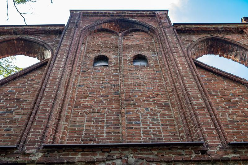 An old church in Central Europe. A religious building of red brick worship. Season of the aun stock images