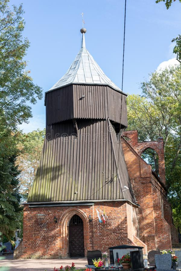 An old church in Central Europe. A religious building of red brick worship. Season of the aun stock photos