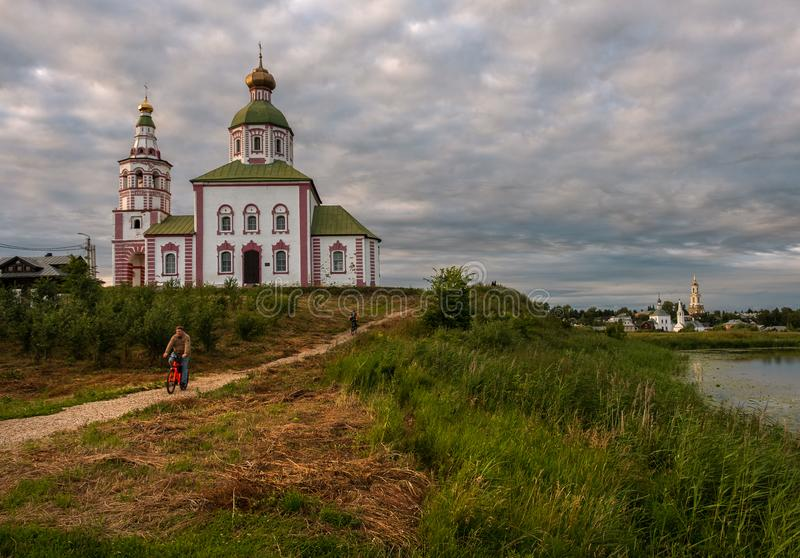 Old church in the city of Suzdal at sunset. Bridge over the river, water lilies. The beauty of the Russian province. Russia at. Old church in the city of Suzdal royalty free stock images