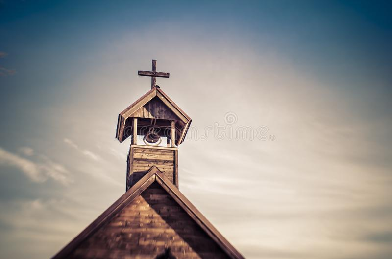 Old church with cross lit by gorgeous light copy space. Old church with cross lit by gorgeous light sky copy space area royalty free stock photo