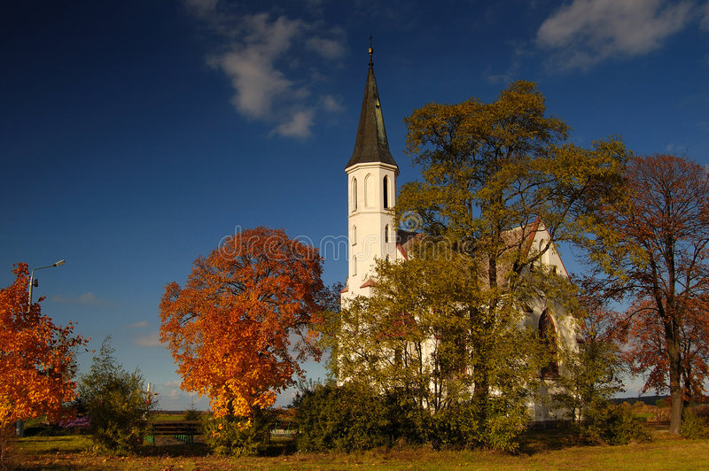 Old church in fields royalty free stock image