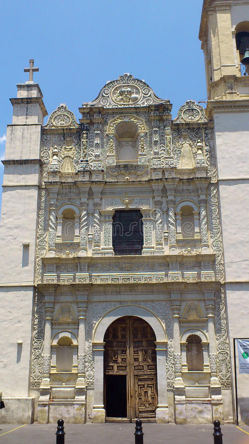 Old church front face in mexico sixteen century. A old front face of one traditional spanish church remains in a street of mexico with many architectural details stock images