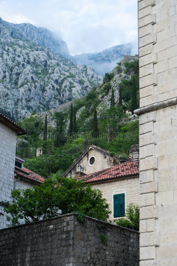 Old church inside Stari Grad, Kotor, Montenegro. Kotor bay and Old Town from Lovcen Mountain. Montenegro. Tower with mountains in. The background, europe royalty free stock image
