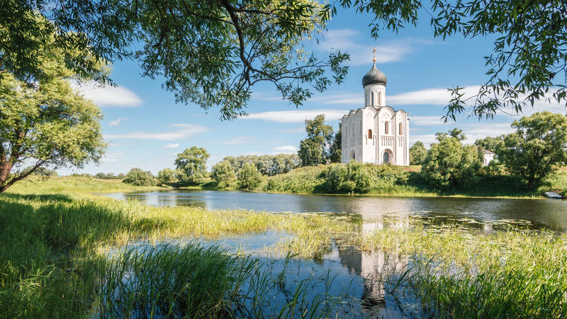 Old church reflected in the lake royalty free stock photo