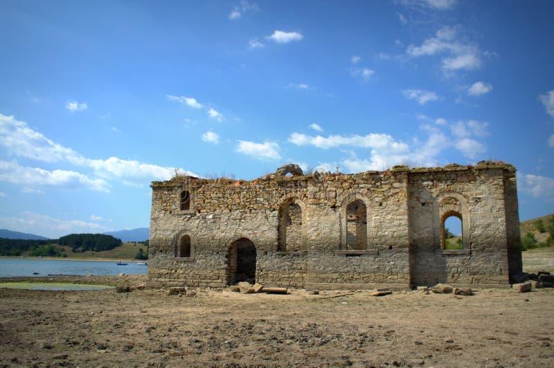 Old church ruins,Bulgaria. The ruins of St. Ivan Rilski church at the shore of Zhrebchevo reservoir on dry summer season,Bulgaria stock photo