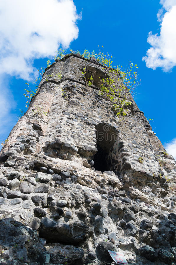 Old church ruins. Cagsawa Ruins are the remnants of an 18th century Franciscan church, built in 1724 and destroyed by the 1814 eruption of the Mayon Volcano royalty free stock photo