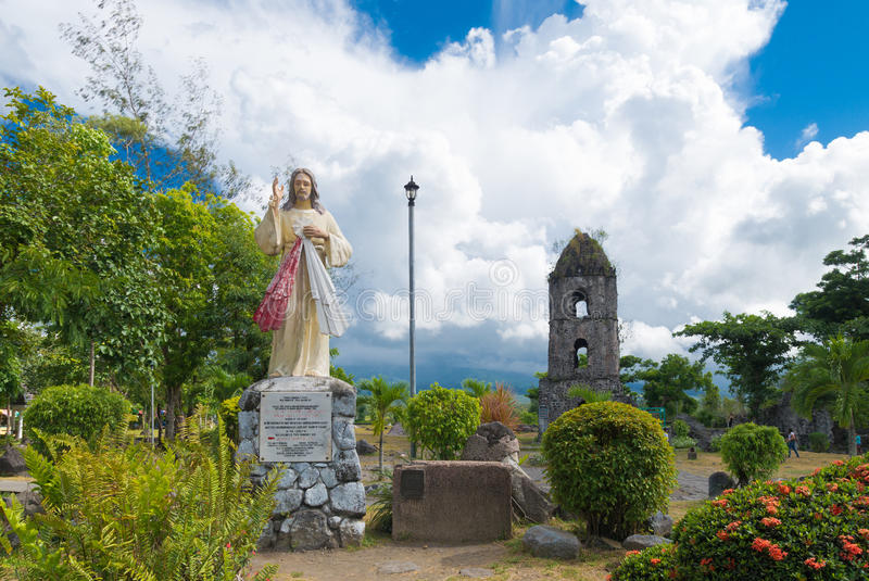 Old church ruins with jesus sculpture. Jesus sculpture in front of the Cagsawa Ruins, the remnants of an 18th century Franciscan church, built in 1724 and stock image
