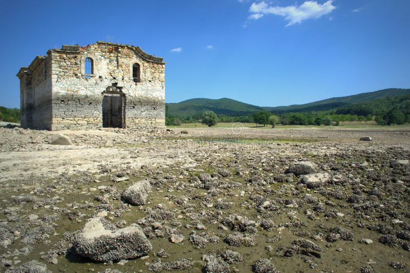 Old church ruins. The ruins of St. Ivan Rilski church at the shore of Zhrebchevo reservoir on dry summer season,Bulgaria stock image