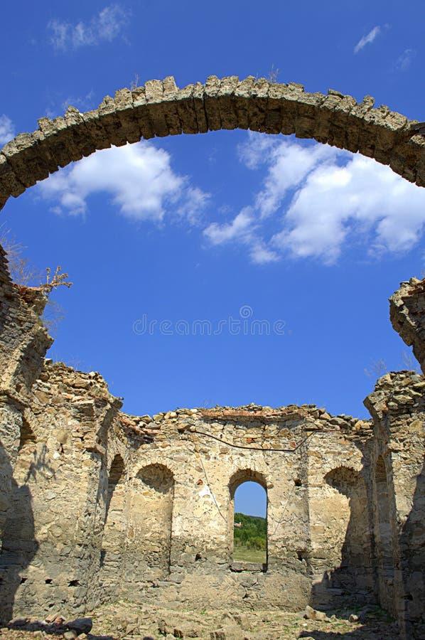 Old church ruins. The ruins of St. Ivan Rilski church at the shore of Zhrebchevo reservoir on dry summer season,Bulgaria stock photography