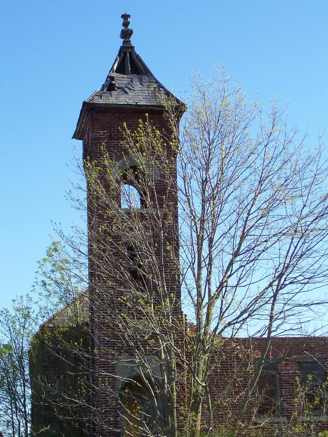 Old church steeple in spring time royalty free stock photography