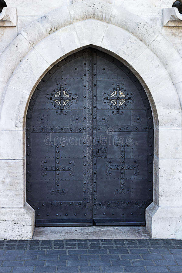 Old church textured door with stone arch stock photos