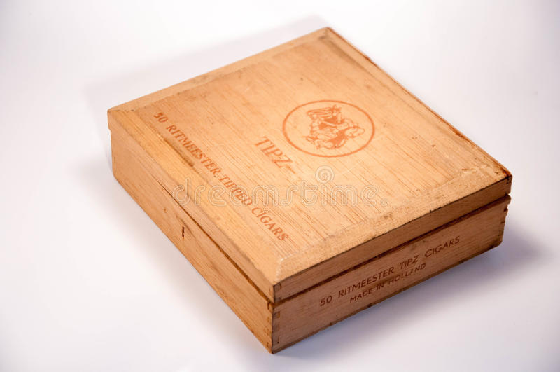 An old cigar box. Thailand. April 09, 2017 : An old cigar box. a wooden case of TIPZ`s cigar of Holland. Vintage wooden cigar box of Holland. 09 April 2017 royalty free stock photo