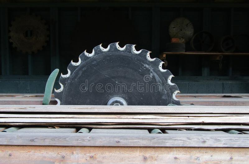 Old circular wood saw disk. In carpentry workshop royalty free stock photography
