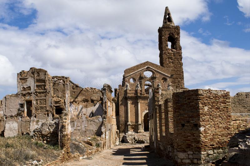 STREETS in Ruins of `Belchite` TOWN after the world war II. OLD CITY of `Belchite`, Spain. This is the main street that leads to the church of the old town stock images