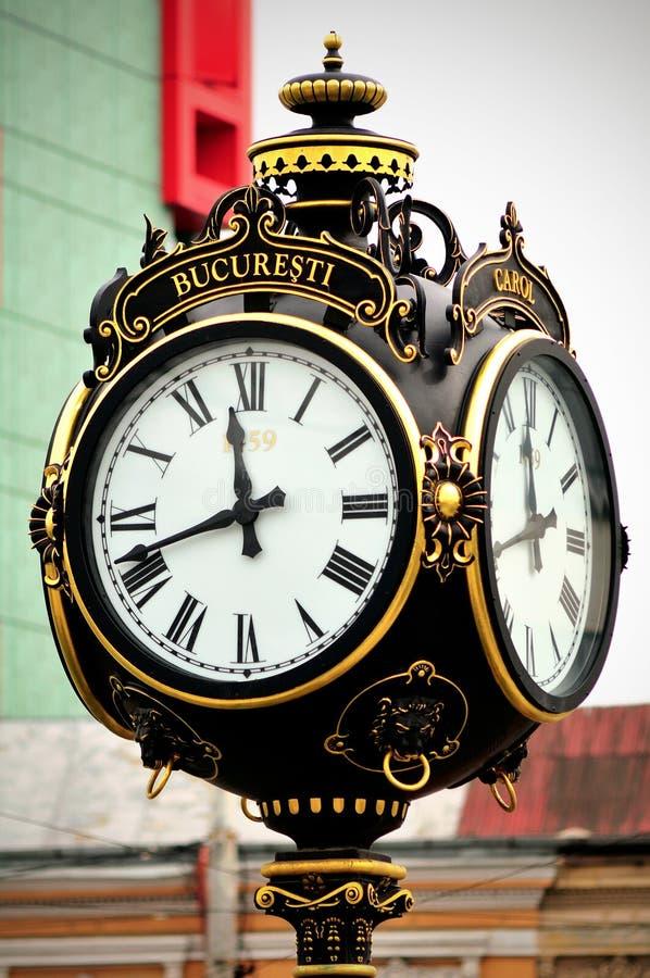 Old city clock. Old rebuilt Carols clock in Bucharest stock images