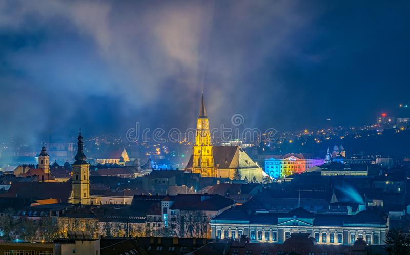The old city of Cluj-Napoca with the Franciscan Church and St. Michael`s Church viewed from Cetatuia Park at night in Cluj-Napoca. Romania royalty free stock images
