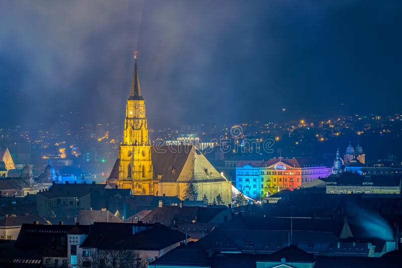 The old city of Cluj-Napoca with the Franciscan Church and St. Michael`s Church viewed from Cetatuia Park at night in Cluj-Napoca. Romania royalty free stock photography