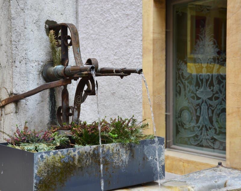Old city fountain in Neuchatel Switzerland stock photos