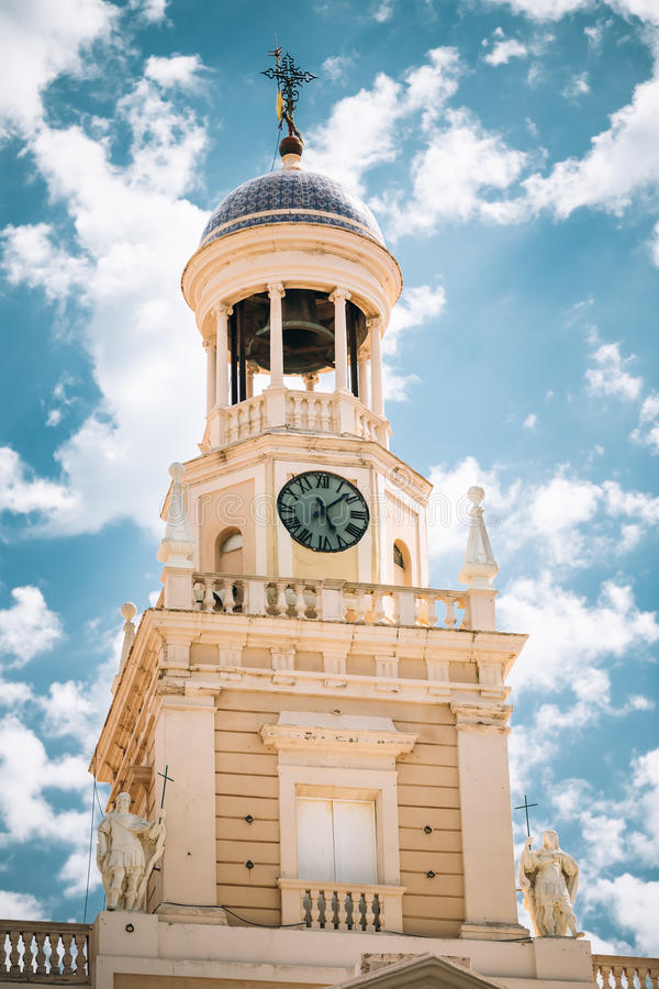 Old city hall in Cadiz, Spain. Clock tower on blue. Sky background stock photo