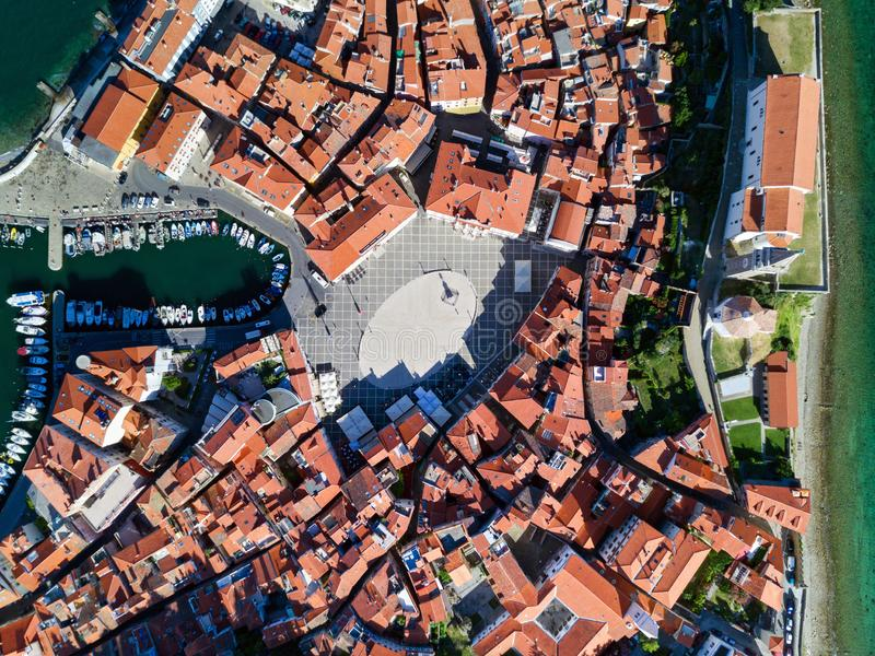 Old city Piran in Slovenia, aerial view of Tartini Square, St. George`s Parish Church and marina stock photography