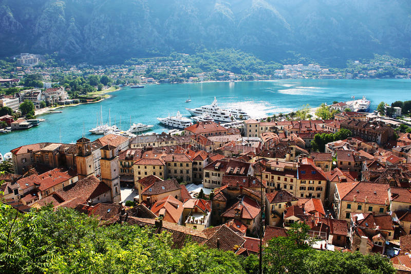 Old city and port of Kotor, turquoise water and boats stock photo