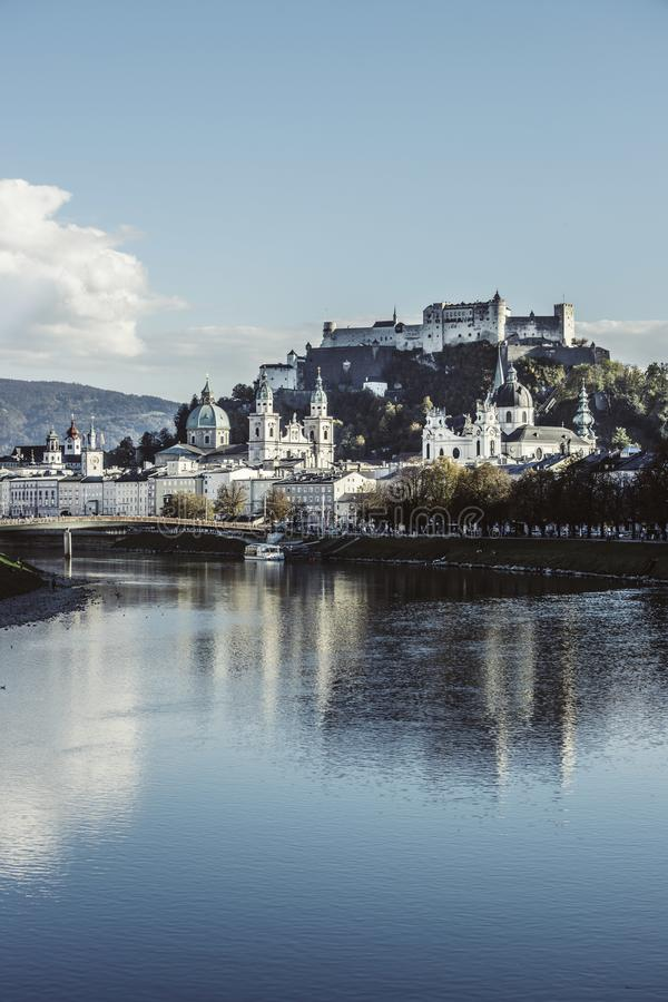 Old city of Salzburg an the river Salzach, magical old city, Europe. Salzburgs old city with fortress Hohensalzburg, blue sky europe magical trip holiday break royalty free stock images