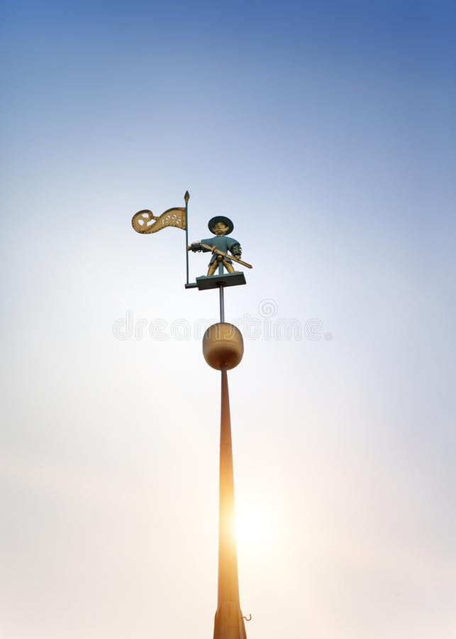 Old city, Tallinn, Estonia. A medieval weather vane Old Thomas on the Town hall tower royalty free stock photography