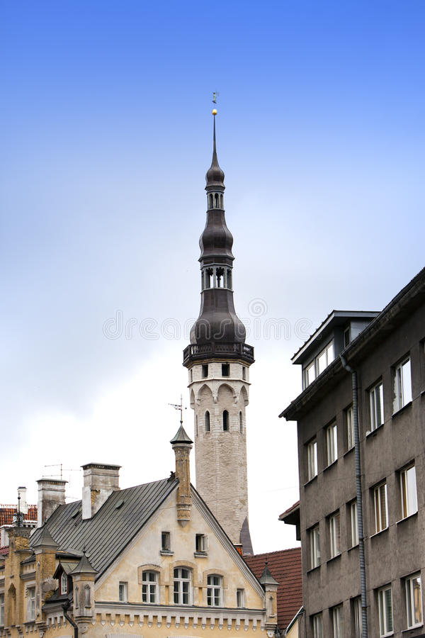 Old city, Tallinn, Estonia. A old houses and weather vane Old Thomas on the Town hall tower. Old city Tallinn, Estonia. A old houses and weather vane Old Thomas stock photography