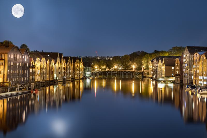 Trondheim and Nidelva River at 2 am in the night with full moon, Norway royalty free stock photography