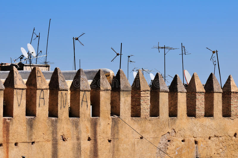Old city wall. Part of old city wall and antennas in Fes, Morocco royalty free stock images