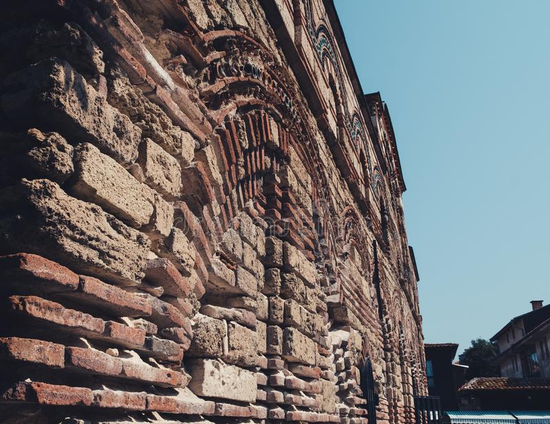 Old city wall and buildings. Fragment of old city wall stock photography