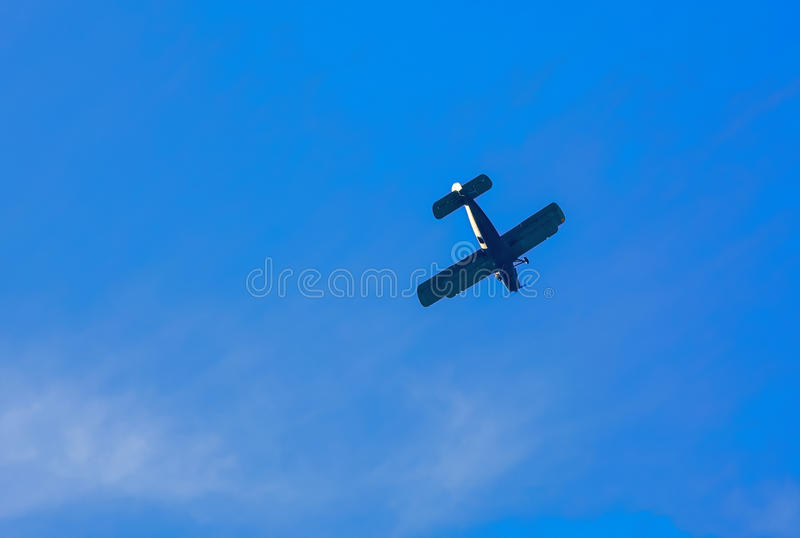 Old civil plane AN2 airplane. Old civil plane AN2 flying to the dark blue sky royalty free stock photography