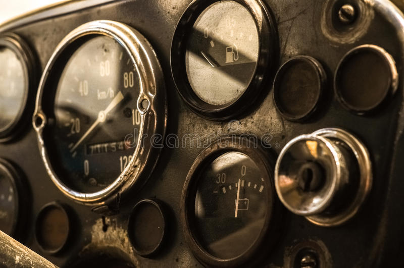 Old classic dashboard of the truck automobile. Vintage retro Gauges, fuel, battery, speedometer. Ignition lock stock image