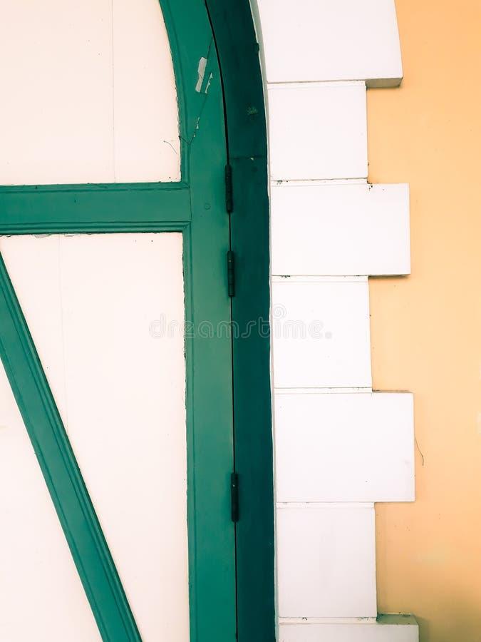 Old classic door and window, abstract door background. Old wooden abstract door backgrounds painted in beautiful color, The old dilapidated door house stock image