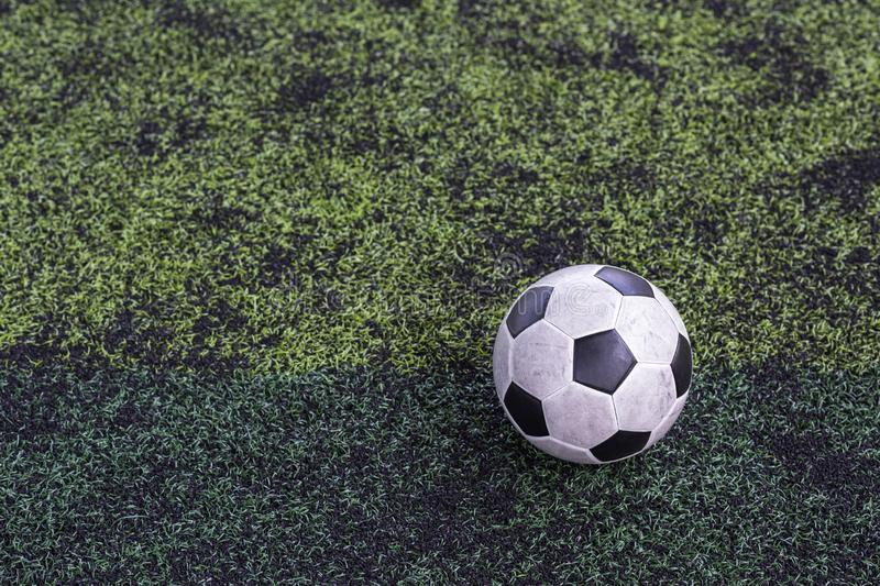 Old classic football on soccer grass royalty free stock photos