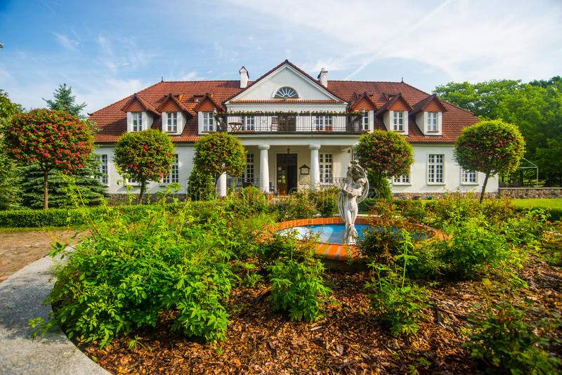 Old classic manor house. Beautifully restored classic Polish manor house serving as a hotel in Bychowo, northern Poland stock photo