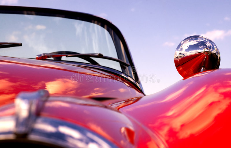Old classic red jaguar at beach stock photography