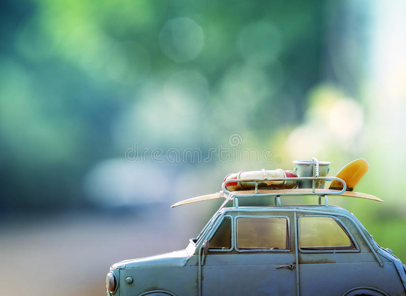 Old classic retro car with surf board and beach tool on roof ag royalty free stock photography