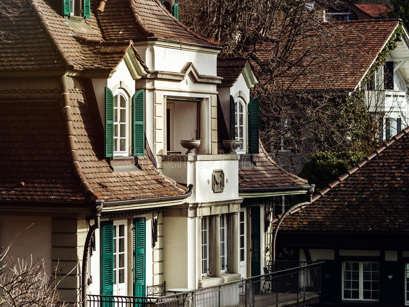 Old classic style windows of Switzerland. Renovated house stock images