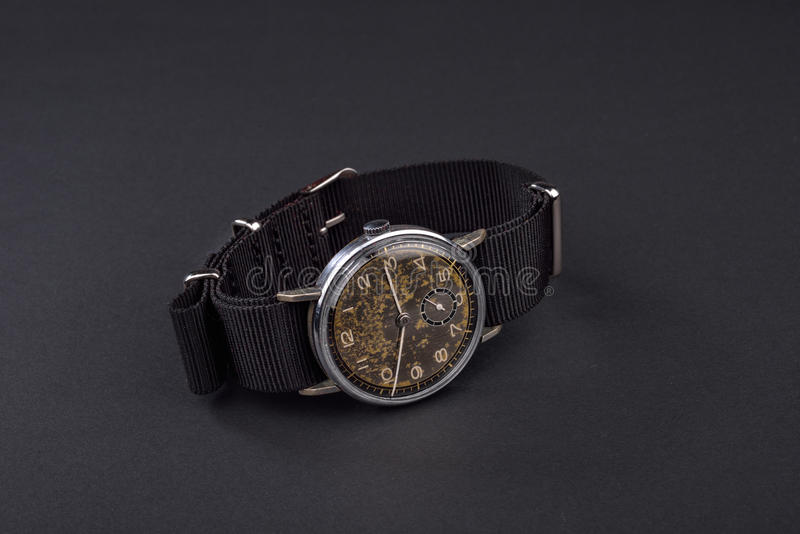 Old classic wristwatch for man on black background. Old classic wristwatch for man on black royalty free stock image