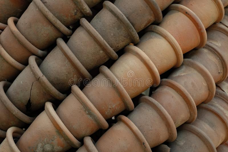 Old clay pots in layers. Traditional gardening tool. Old clay pots in layers. Traditional gardening's tool, pottery, ceramic, background, vase, handmade stock photography