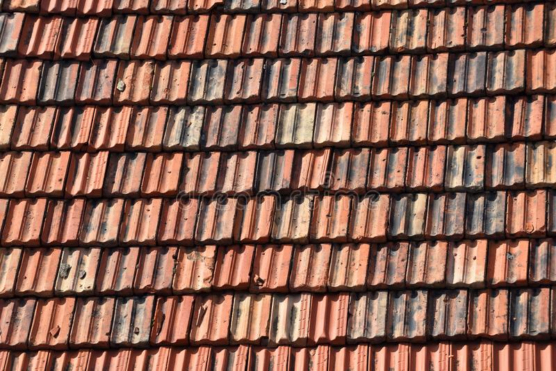 Old Clay Roof Tiles. Detail of a house roof made with red clay tiles royalty free stock photography