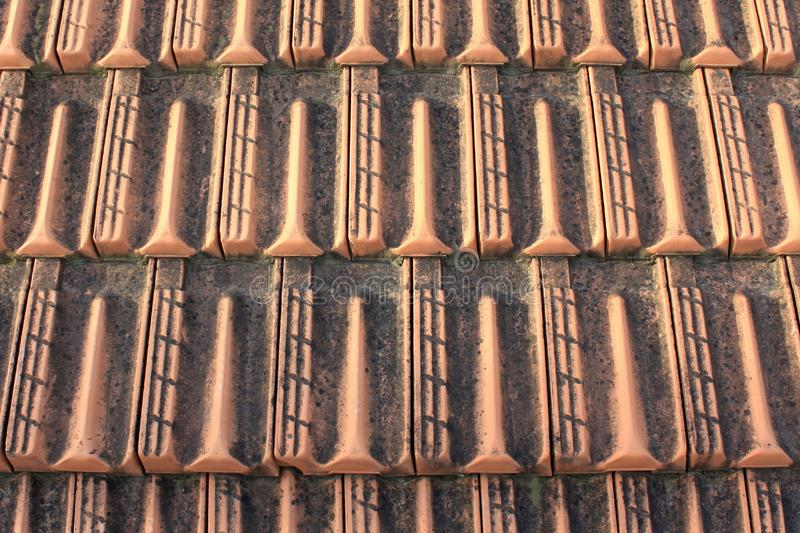 Old clay roof tiles for house as natural brown background. With uniform pattern royalty free stock photos