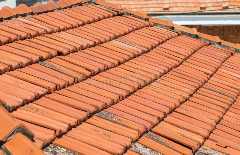Old clay roof tiles. Taken in Limassol, Cyprus of an old bungalow`s roof, showing the clay tiles royalty free stock photo