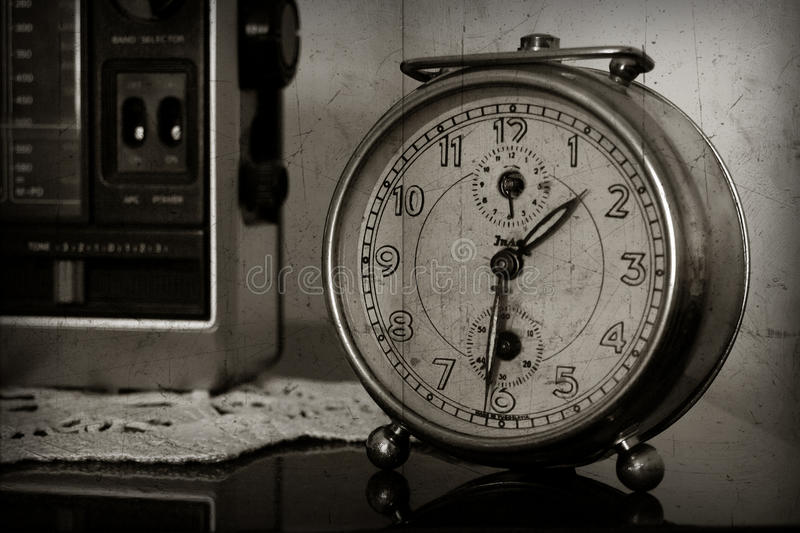 Old clock. Granny's old clock on the old sofa royalty free stock photography