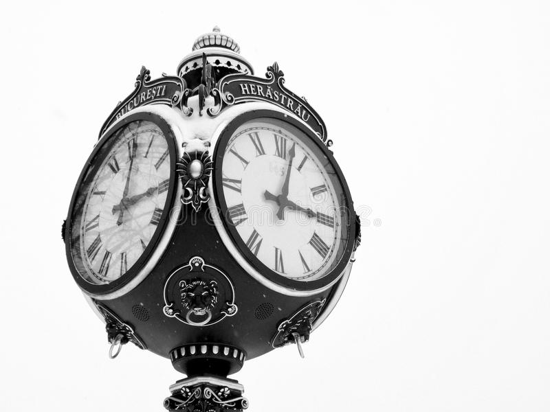 Old clock. Black and white image with old clock in Bucharest, Romania stock photography