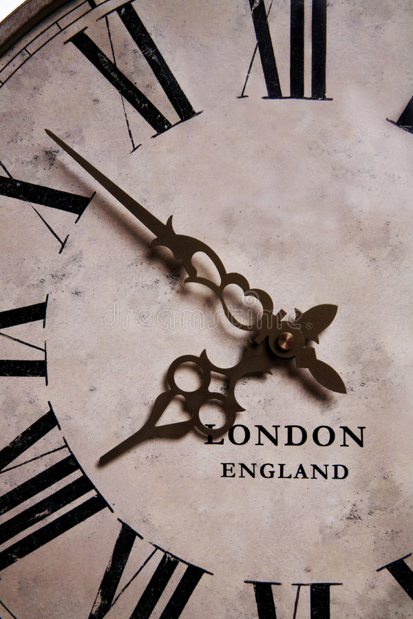Old Clock. An old antique vintage grandfather clock close-up stock photos