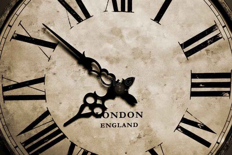 Old Clock. An old antique vintage grandfather clock close-up stock images